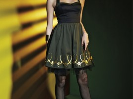 Part of the Marvel by Her Universe collection designed by last year's fashion show winner, Amy Beth Christenson, with Her Universe, is this Loki Halter Dress available next month exclusively at Hot Topic.